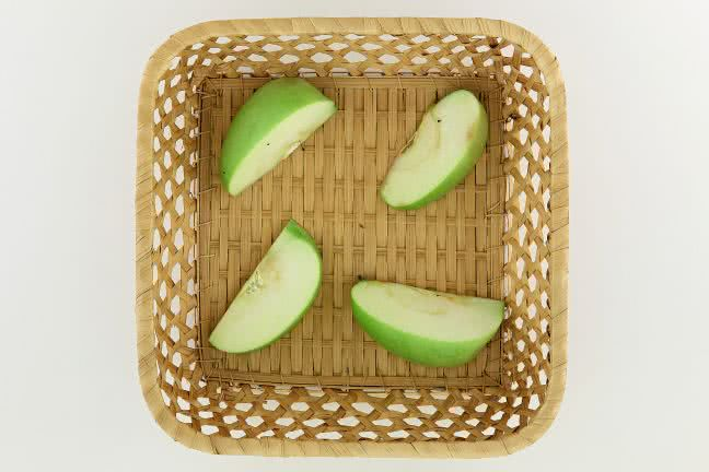 Cut apple in a small basket - free stock photo